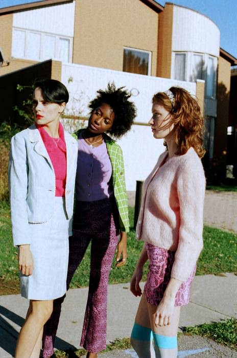 Adrien wears blazer, skirt, and top from 69 Vintage. Miamouna wears blazer from 69 Vintage, sweater from House of Vintage, and Petra's pants. Carly wears sweater from House of Vintage, Petra's skirt, and knee highs from American Apparel.