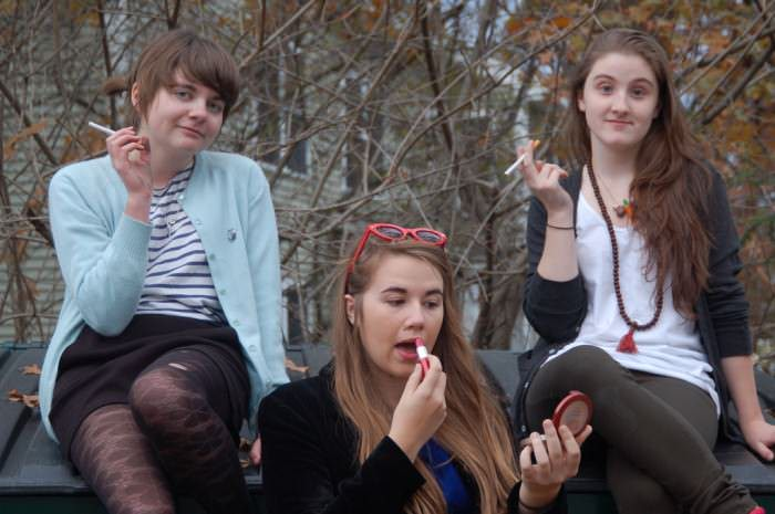 We're Clara (17), Catherine (15), and Alyssa (17), a girl gang from New England. This year we founded a feminist/Riot Grrrl club at our high school, doing creative projects around the school to educate the other students! —HHS Riot Grrrls