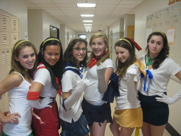 Left to right: Faith, Amber, Giovanna, Sara, Jill (me!), and Hallie. This is my girl gang dressed up as one of the greatest girl gangs of all time, the Sailor Scouts, for superhero day our senior year. —Jill