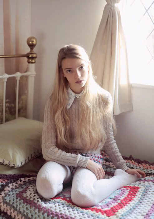Anya wears collar by Miu Miu, jumper by American Apparel, shorts and tights by Topshop.