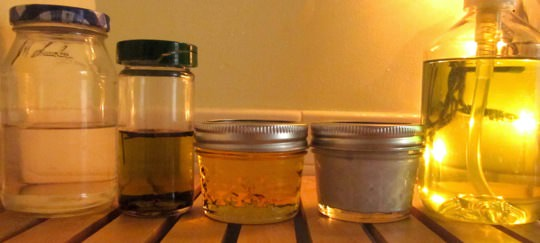 Left to right: mouthwash in a Smucker's jelly jar, fresh lavendar-infused olive oil (remarkably effective as a moisturizer) in an old spice jar; jojoba oil and lavendar body lotion in jelly jars; hand soap in a plastic soap dispenser with the label removed