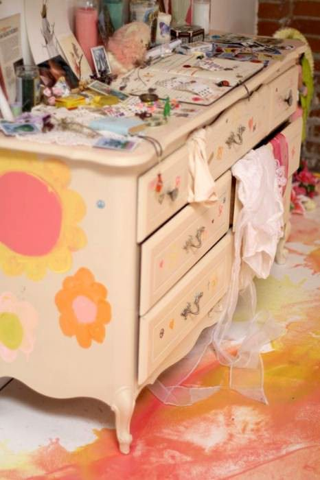 Anna did most of the painting job for all the cute flowers and planets on the furniture.