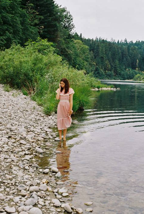 Hazel in a river by the Redwoods. Vintage dress.
