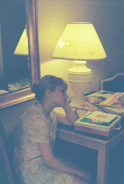 Me in our hotel room in Iowa, presumably thinking some very deep thoughts. Vintage dress.