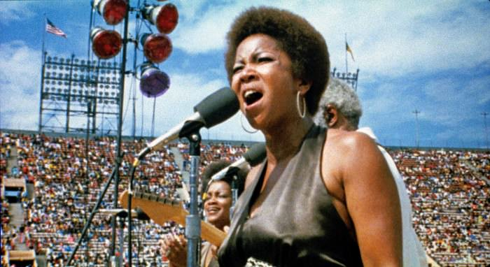 Mavis Staples performing at the Wattstax concert at the Los Angeles Memorial Coliseum in 1972. Via Wattstax.