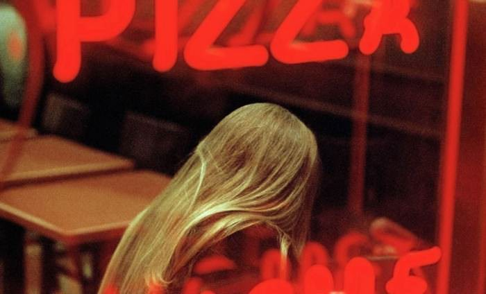 """A young woman in a pizza parlor,"" Times Square, New York, 2005. Photograph by  Constantine Manos, © Constantine Manos/Magnum Photos."