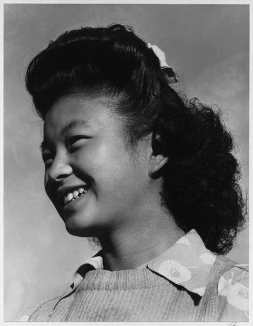 Portrait of Manzanar internee Yeko Yamamoto by Ansel Adams, 1943. From the Library of Congress, via Of Another Fashion.