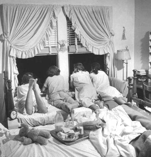 Teenage Girls at a Slumber Party Talking to Boys Who Are Standing Outside by Ed Clark for Life magazine, December 20, 1948; via Art.com.