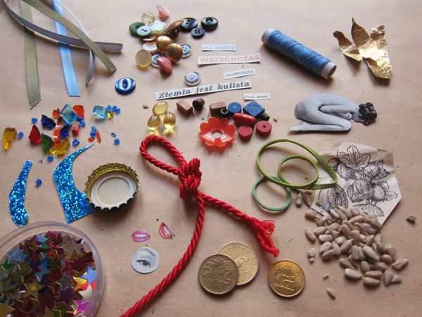 description: I'm gonna use some random junk found on my desk: beads, ribbons, cord, buttons, cutouts, seeds, rubber bands, coins, vitamin pills. This should be enough material for at least 50 Secrets!