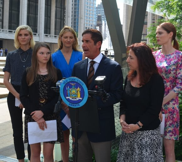 New York state senators Jeff Klein, center, and Diane Savino, center right, with members of the Model Alliance.