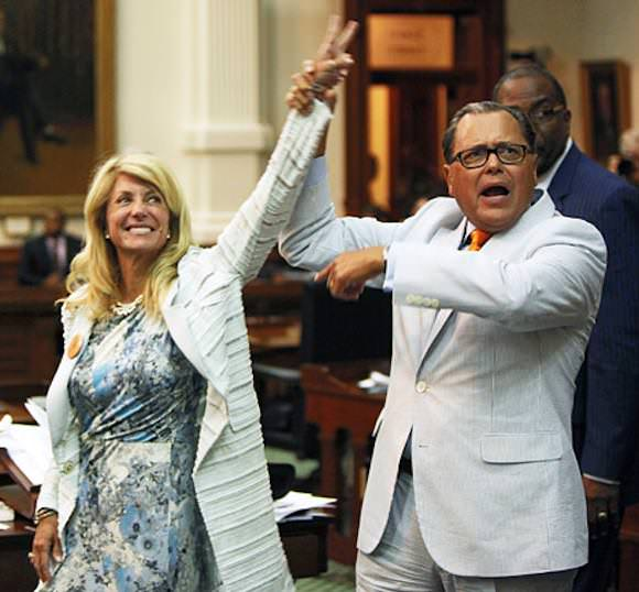 Texas State Sen. Wendy Davis being congratulated by her colleague, State Sen. José Rodríguez.