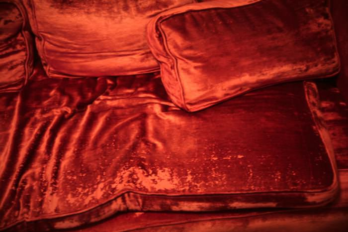 Rest in Peace Red Velvet Couch by  Berit Heggenhougen-Jensen.