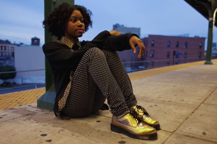 Francesca is wearing gold patent-leather Dr. Martens 3989s.