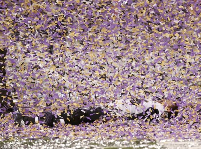 Morgan Cox of the Baltimore Ravens on the New Orleans Superdome field after his team has just won the Super Bowl, 2013. Photo by Mike Segar/Reuters, via Totally Cool Pix.
