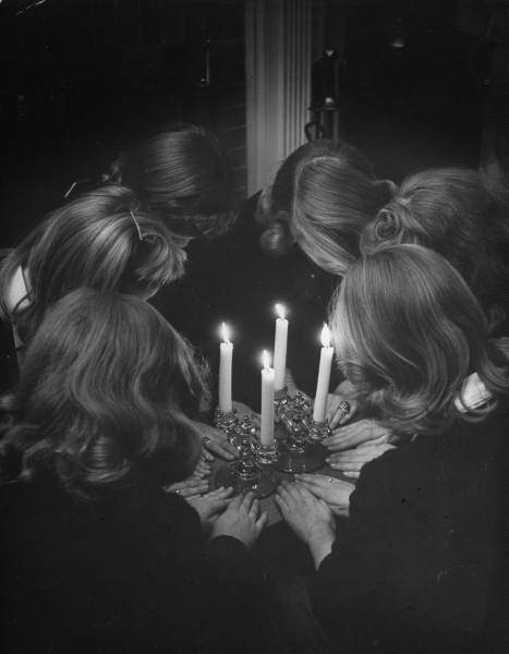 Girls in a high school sorority re-enacting a secret initiation ritual, Webster Groves, Missouri, 1944. Photo by Nina Leen for Life magazine.
