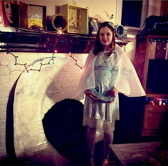 "Liz's own description of her costume: ""Here's me and my nine-months pregnant belly (baby Strummer) as many moons!"" (Johnson City, Tennessee)"