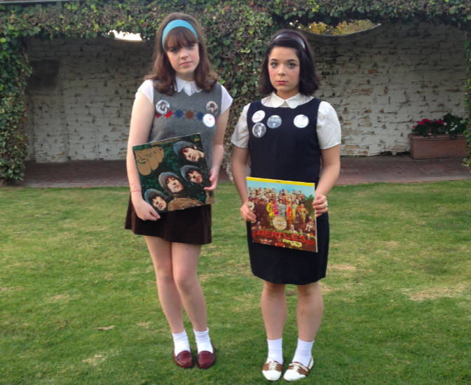 Gracie (left) and Gabby as 1960s Beatles fangirls. (California)