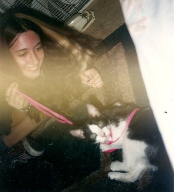 Teenage me and baby Sid playing with a shoelace.