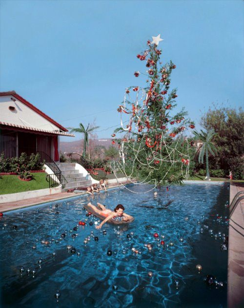 Christmas Swim, c. 1954, by Slim Aarons. Via Photographers Gallery.