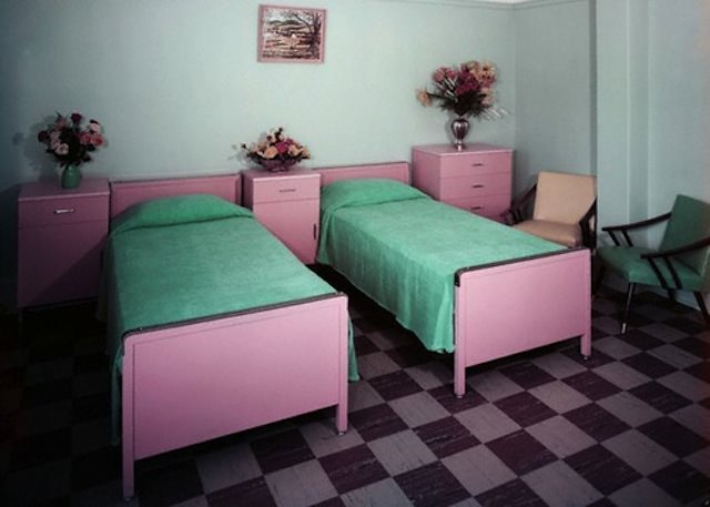 Two empty beds at the Crown Nursing Home in Brooklyn, c. 1960s. Photo by Aladdin Color Inc. via Corbis Images.
