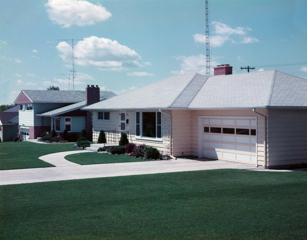Photograph of a suburban home in Crookston, Minnesota, 1957, by O. Johnson. Via Corbis.
