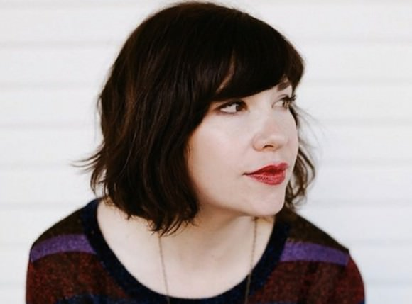 The delightful and perfect Carrie Brownstein. Photo via Stereogum.