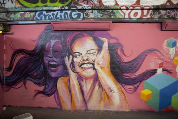 Part of the massive Femme Fierce mural. Photo via the Independent.