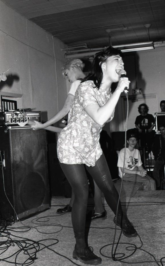 Kathi Wilcox, right, with bass, and Kathleen Hanna, left, with microphone