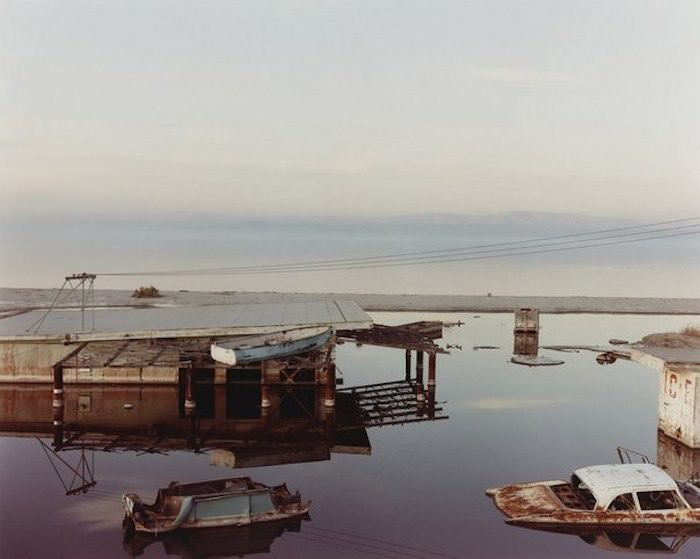 Stranded Rowboat, Salton Sea (1983) by Richard Misrach, via MutualArt.com.