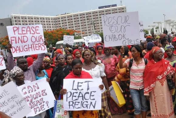 Protestors in Abuja, Nigeria demanding that their government step up. Photo by Deji Yake/European Pressphoto Agency via the New York Times.