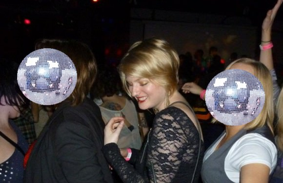 Me, center, with two disco balls I happened to be in a conga line with recently.