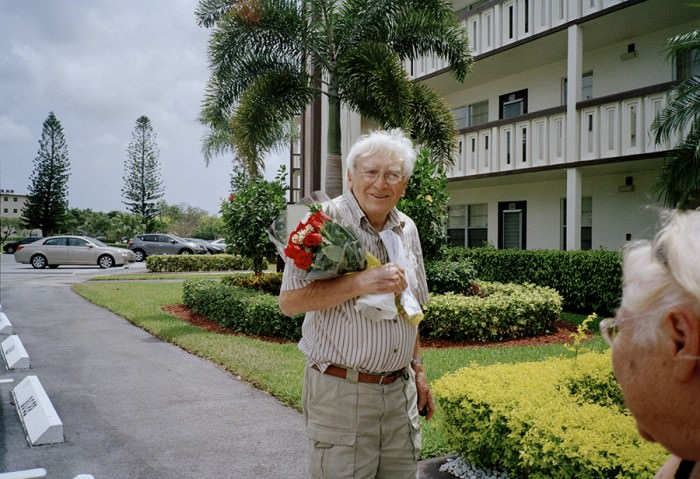 A friend of my grandmother's bringing flowers to his wife for Mother's Day.