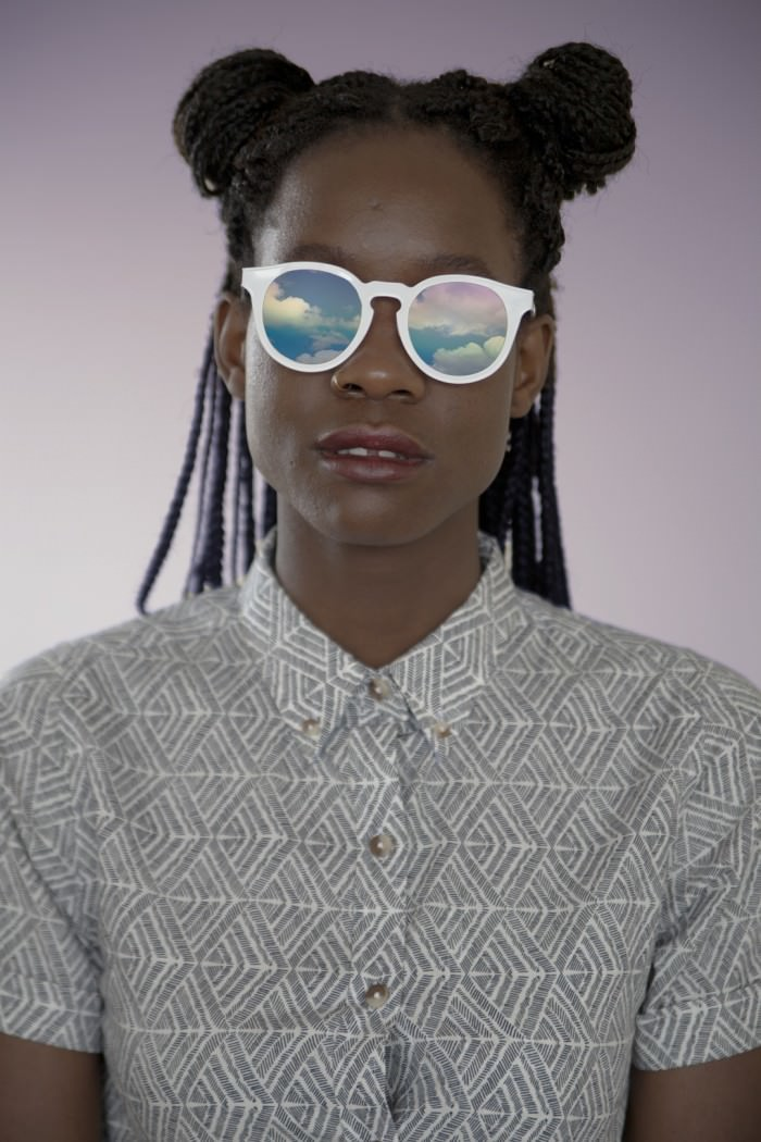 On Ornello: sunglasses by Quay, shirt by Wildfang.