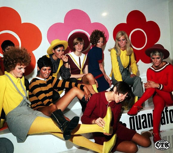 Mary Quant (center, in red dress) and models displaying her 1967 collection. Photo by PA Archive/PA Photos.