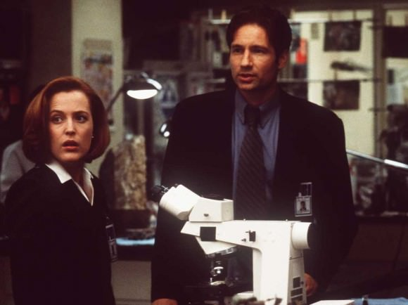 Photo of Gillian Anderson and David Duchovny as Dana Scully and Fox Mulder in the X-Files, via NPR.