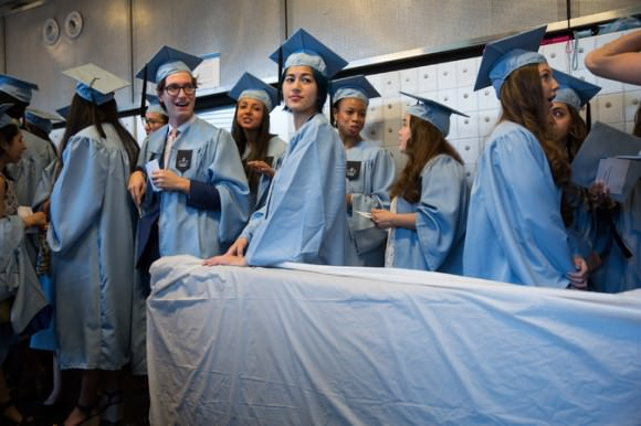 Emma Sulkowicz, center, with her mattress at Class Day, a graduation event for seniors at Columbia College. By Michael Appleton for the New York Times.