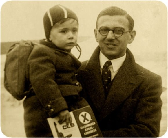 Photo of Nicholas Winton with a child, via the New York Times.