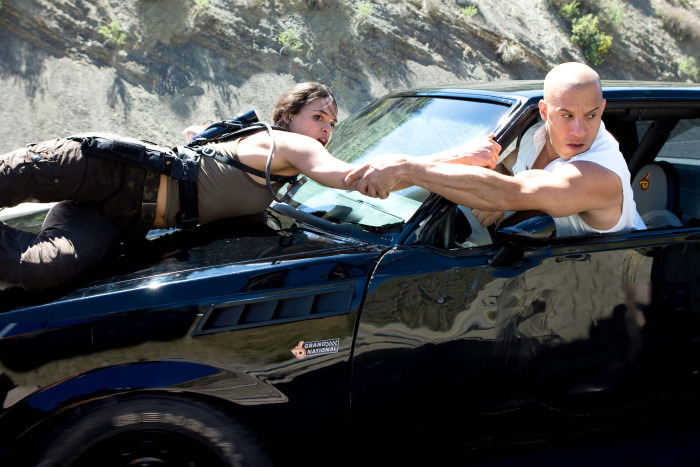 Michelle Rodriguez as Letty and Vin Diesel as Dominic in The Fast and the Furious.