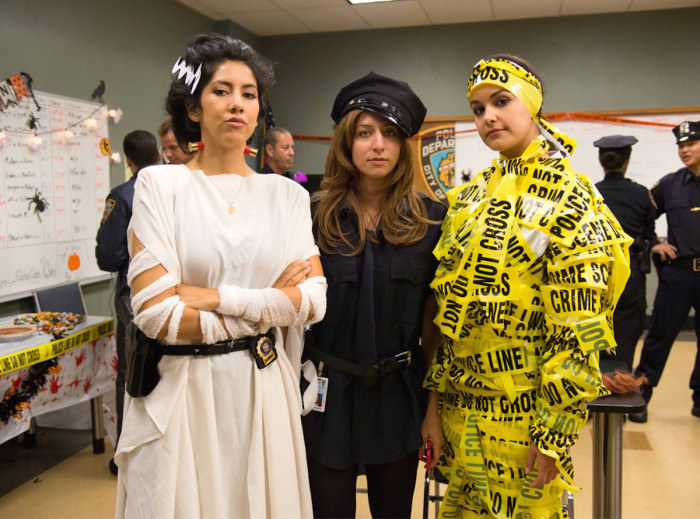 Stephanie Beatriz as Rosa Diaz,  Chelsea Peretti as Gina Linetti, and Melissa Fumero  as Amy Santiago  on Brooklyn Nine-Nine.